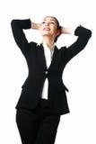 Donna soddisfatta di affari con le mani dietro il suo hea Fotografia Stock