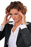 Donna sollecitata di affari che massaggia le sue tempie Fotografia Stock Libera da Diritti