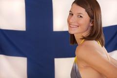 Donna sopra la bandierina finlandese Fotografie Stock Libere da Diritti