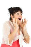 Donna sorpresa che osserva in su lo spazio della copia su bianco. Immagine Stock Libera da Diritti