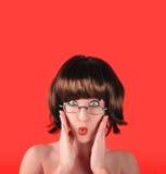 Donna sorpresa con priorità bassa rossa Immagine Stock Libera da Diritti