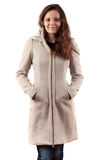 Donna sorridente in cappotto beige Fotografia Stock