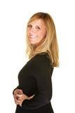 Donna sorridente che esamina spalla Immagini Stock Libere da Diritti