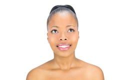 Donna sorridente che guarda verso l'alto Fotografie Stock
