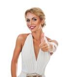Donna sorridente che mostra il segno del tumb Immagini Stock Libere da Diritti