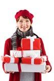 Donna sorridente che tiene i grandi presente Fotografie Stock