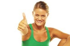 Donna sorridente con i pollici in su Immagini Stock