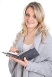 Donna sorridente con il calendario Fotografia Stock