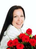 Donna sorridente con il mazzo dei fiori Fotografie Stock Libere da Diritti