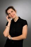 Donna sorridente con il mobile Immagine Stock Libera da Diritti