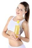 Donna sorridente con la bottiglia del supplemento della vitamina fotografia stock