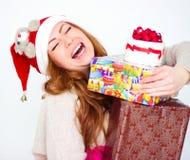 donna sorridente con molti contenitori di regalo Fotografia Stock