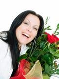 Donna sorridente del brunette con il mazzo dei fiori Fotografia Stock Libera da Diritti