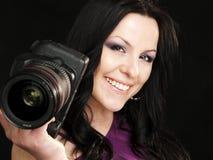Donna sorridente del fotografo Fotografia Stock