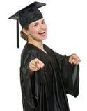 Donna sorridente dell'allievo di graduazione che indica su voi Fotografia Stock Libera da Diritti