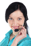 Donna sorridente dell'operatore in una call center immagine stock