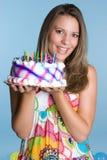 Donna sorridente della torta immagine stock libera da diritti