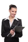 Donna sorridente di affari che tiene una cartella Fotografia Stock