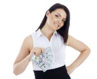 Donna sorridente di affari con contanti disponibili Fotografia Stock