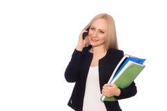 Donna sorridente di affari con le cartelle ed il telefono Fotografia Stock Libera da Diritti