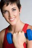 Donna sorridente di allenamento Fotografia Stock