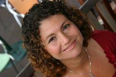 Donna sorridente graziosa Immagine Stock