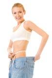 Donna sottile in vecchi jeans Fotografia Stock