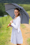 Donna sotto l'ombrello Fotografia Stock
