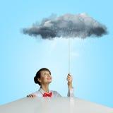 Donna sotto pioggia Fotografia Stock