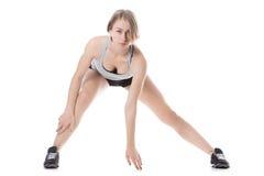 Donna sportiva che fa allungando gli esercizi Fotografia Stock Libera da Diritti