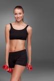 Donna sportiva che fa esercizio aerobico Immagini Stock Libere da Diritti