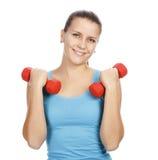 Donna sportiva che sorride a voi Fotografia Stock Libera da Diritti