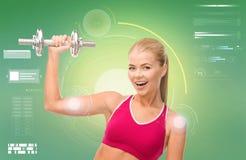 Donna sportiva felice con la testa di legno che flette il bicipite Fotografie Stock Libere da Diritti