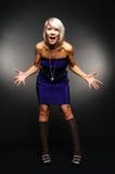 Donna stupita in vestito blu Immagini Stock