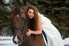 Donna su un cavallo Immagini Stock