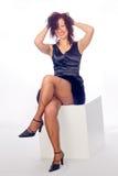 Donna su un cubo Fotografia Stock Libera da Diritti