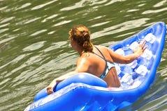 Donna su un galleggiante Immagine Stock Libera da Diritti