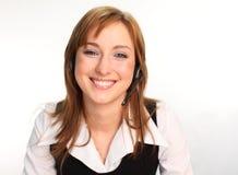 Donna su una conversazione della cuffia avricolare fotografie stock libere da diritti