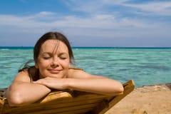 Donna su una spiaggia Immagine Stock Libera da Diritti