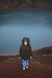Donna su Volcano Red Ground Fotografia Stock Libera da Diritti