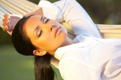 Donna sul hammock Fotografie Stock