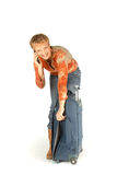 Donna sul telefono con la valigia Immagini Stock