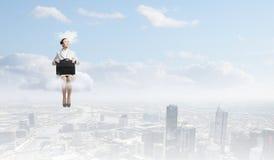 Donna sulla nuvola Fotografie Stock Libere da Diritti