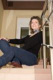 Donna sulla scaletta fotografia stock