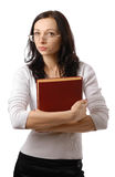 Donna sveglia con lo sguardo sospettoso ed il grande libro Immagine Stock Libera da Diritti