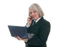 Donna sveglia di affari con il computer portatile Fotografia Stock