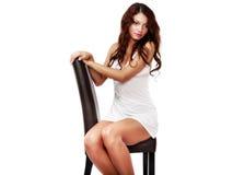 Donna sveglia e sexy in biancheria isolata su bianco Fotografie Stock