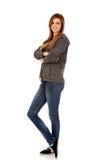 Donna teenager felice con le armi piegate Fotografia Stock Libera da Diritti