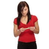 Donna triste con la prova di gravidanza Immagine Stock
