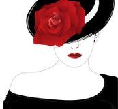 Donna in un cappello con una rosa Fotografie Stock Libere da Diritti